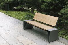 Contemporary public bench in wood and metal (with backrest) RADIUM by David Karásek, Radek Hegmon  mmcité 1 a.s.