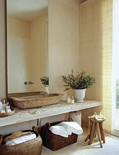 Teknő! Rustic bathroom with stone bench and wooden tub.