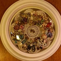 I used vintage jewelry ( some broken) of family members to make a wreath.