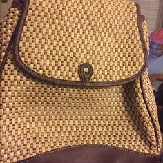 "Vintage Aigner Backpack This is a very nice Etienne Aigner weave and patent leather (or faux) cross body bag.  The strap is adjustable and will go down to around 19"". This bag has a flap closure with a magnetic snap.  There is the gold-tone letter 'A"" on the patent leather flap trim.   The outside back of the back has a large pocket with a magnetic snap closure.  Inside, there are 2 main sections, both lined in a very pretty cream-colored faille.  The front section is open space and the back…"