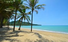 Kamala Beach in Phuket Thailand at it's best! Palm trees, bright blue sky, turquoise sea water and white sand between your toes. Lay back and enjoy yourself! And feel free to request your room at PapaCrab Boutique Guesthouse today!