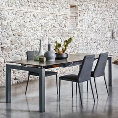 Calligaris Airport Table; FREE UK DELIVERY. Long but narrow contemporary glass dining table with space saving glass top extension, seating 6 to 12 people.