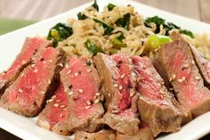 Mirin-Marinated Strip Steaks with Scallion-Kale Ramen: New York strip steaks marinated in mirin, garlic and soy sauce, grilled and served with ramen noodles tossed with sautéed kale and scallions.
