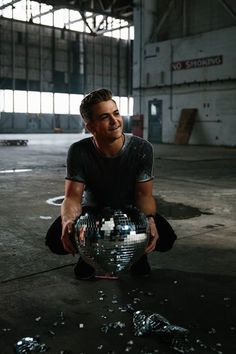 Hunter Hayes my amazing and wonderful love posing with an amazing and beautiful smile holding a disco ball he's so gorgeous and handsome I love him always and forever with all my heart