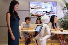 Pizza Hut hires ROBOT waiters to take orders and process payments
