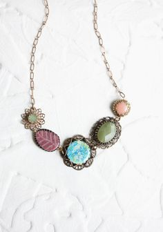 """Awaiting Bloom Indie Stone Necklace 38.99 at shopruche.com. Ornate brass findings are paired with faceted stone accents and floral charms to create an elegant vintage-styled necklace.19""""long"""