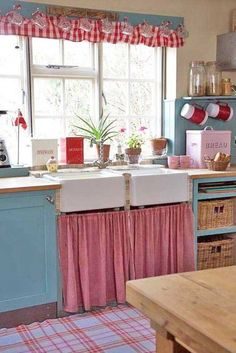 Farmhouse style kitchen- love the valance of cups, on pegs, above the sink. Photobucket