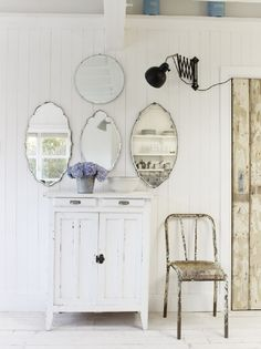 Use a collection of Vintage Mirrors to visually add room to a space and interest to a wall ~ clever and cool!