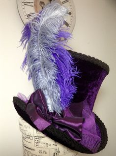 Purple velvet mad hat top hat, with grey and purple side ostrich plums, purple taffeta and tulle accessory and purple tulle band.  Made in my own workshop in Scotland   https://www.etsy.com/uk/shop/Blackpin?ref=hdr_shop_menu | Shop this product here: spree.to/as4s | Shop all of our products at http://spreesy.com/jessycat    | Pinterest selling powered by Spreesy.com