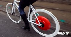These Guys From MIT Just Reinvented The Bicycle Wheel | 9gag.tv - Imagine cruising through the city on a bike at 20 mph without exerting much effort? That's what a hybrid bike can do. Any ordinary bike can be turned into a hybrid through the Copenhagen Wheel—a motorized disk unit that attaches to the rear wheel.