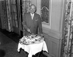 Former President Harry S. Truman smiles as he cuts a birthday cake to celebrate his 73rd birthday. He was honored at a luncheon by friends in Kansas City, Missouri at the Muehlebach Hotel, May 8, 1957.