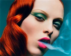 red hair, dramatic eyes, pink lips... even the smoke... love.