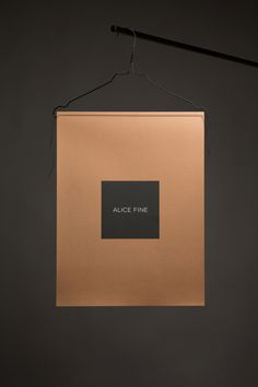Alice Fine AW2013 Look Book Design {what a clever idea - hanging catalog on a hanger} // Morris Pinewood Stockholm