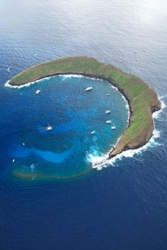 The beautiful Molokini Crater in Maui, #Hawaii is a natural wonder. It's a perfect place for snorkeling and other water activities.