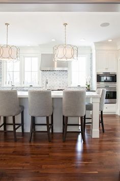 17 amazing kitchen lighting tips and ideas kitchens chandeliers new england design works kitchens sausalito five light chandelier polly beau monde glass french upholstered barrelback barstool love how the aloadofball Choice Image