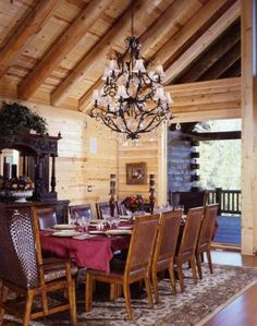 Log home dining room with chandelier