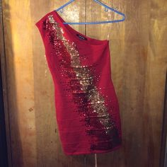 Red dress One shoulder dress. Never worn.  I took the tags off. Brand New . Beautiful dress with gold sequence down the front. If this doesn't sell for the price  I will keep. Price firm no trades, or PP also available on Ⓜ️ WOW couture Dresses One Shoulder