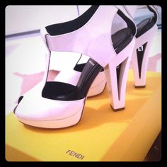 Special Sale price! FENDI White Leather Heels Gorgeous white and black Fendi Heels. New style. Used a few times, light black scuffs. Easily cleanable. Authentic. Will come in Original Fendi Dustbag and Box. FENDI Shoes Heels
