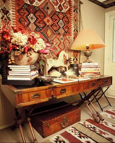 Tribal designs on fabrics, a trunk as an accessory, and fabulous books and collectibles make this look. BELLE VIVIR