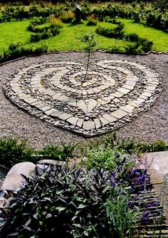 LABYRINTH:... combination of flat + round stones - for the new herb garden path