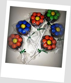 Oreo Flower Milk Chocolate and M pops! perfect for favors, centerpieces, and kids!! Adorable, Customizable, and Deliciously Dipped Oreo Pops. $2.50, via Etsy.