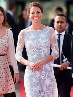 Kate puts on a brave face—and looks gorgeous—after invasive photos are published. http://www.people.com/people/gallery/0,,20629954,00.html#
