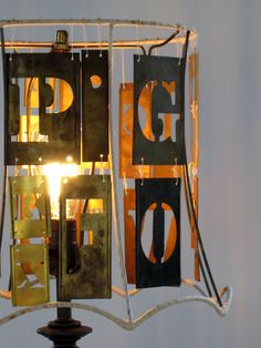 metal stencil lamp shade - diy I like the silverware one best..maybe hanging light in kitchen