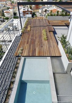 Rooftop design in Athens swimming pool, deck and built-in chaise longues