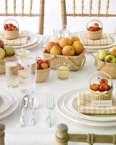 Baskets brimming with fruit imbue a reception with rustic charm. We filled Nantucket baskets in various sizes with warm-toned fruits: pears, apricots, and two kinds of apples. Small baskets laden with blond cherries are arranged at place settings for guests to take home --tiny bows are a graceful touch.