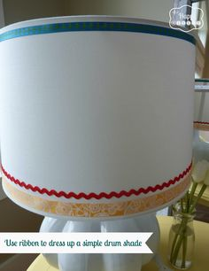 Use ribbon to dress up a simple drum shade -Thrifted Lamp Makeover at thehappyhousie