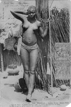Africa | Cérère-None - Young girl. Home of the Nones. The married women only cover themselves with a brief cloth, the girls do not wear but one rudiment of clothing.  Senegal.  ca. 1905, or earlier | Scanned postcard; photographer Edmond Fortier
