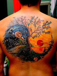 A truly beautiful and work of art Yin Yang tattoo. In full color each side of the tattoo is depicted with a moon and a sun. This means night and day which are opposite concepts but work together to form harmony.