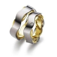 Gerstner wedding rings width: 7 mm Color: white yellow Number, cut and carats of diamonds: 1 briliant 0,02 carat Precious alloy type (at your choice): Gold 585‰ Gold 750‰
