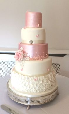 Melina - 5 tier pink and white theme cake with ruffles and lustred tiers