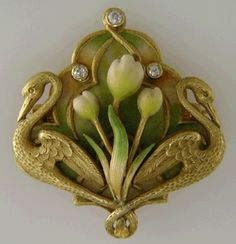 Crafted in 14kt gold,  this brooch was created by Krementz & Company around 1900.  Krementz was one of the premier makers of Art Nouveau jewels in the United States.  One of their hallmarks was the use of pastel enamels,  like the soft yellows,  greens and whites of this brooch.