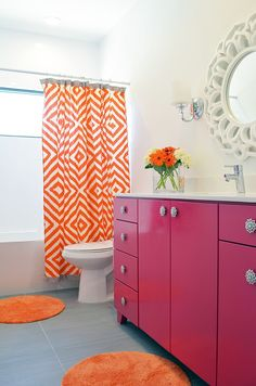 The half-bath could get a facelift with a new mirror like this one /// Snazzy modern bathroom with a pink and orange color scheme [Design: New Leaf Construction]