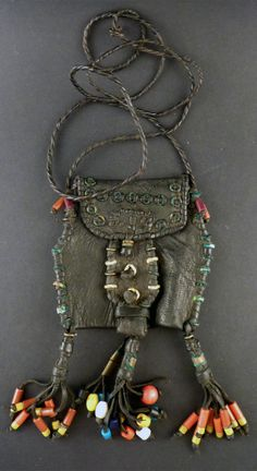 Africa | Pouch bag from the Wodaabe people | Worn similar to a necklace | Leather, brass rings and plastic beads || Source; https://www.etsy.com/ch-en/listing/184304643/african-bororo-wodaabe-leather-pouch-bag