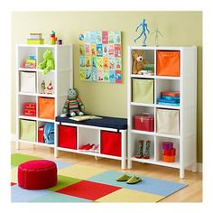 Books in the center and toys on the sides..this could work.