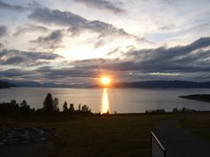 """Midnight Sun on Altafjord, Alta, Norway. Since Alta is within the Arctic Circle, during the summer months the Sun doesn't set. This picture was taken in July, so it was after the summer solstice. (photo: Vberger) ©Mona Evans, """"Why Planets Have Seasons"""" http://www.bellaonline.com/articles/art54046.asp"""