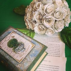 Book Themed Bridal Shower. paper boxes for table snacks and handmade book page roses pinned to styrofoam for Pom centerpiece.