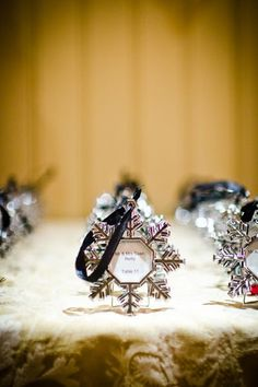 Another idea for place cards.  snowflake ornaments.  Maybe all placed on a big tree?