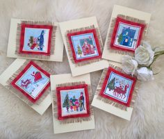 My handmade set of Christmas cards . Printed fabric layered on hessian and stitched to card.