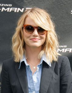 Emma Stone | 31 Celebrity Haircuts That Might Tempt You Into Getting Bangs