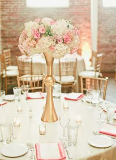 Elegant gold wedding reception centerpiece with pink and white flowers; Featured Photographer: Onelove Photography