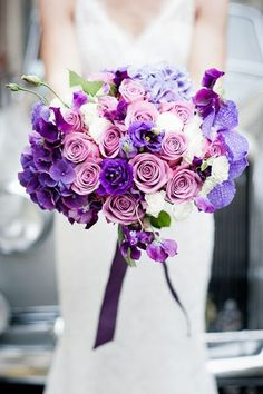 Purple wedding bouquet - roses, hydrangea, orchids and lisianthus