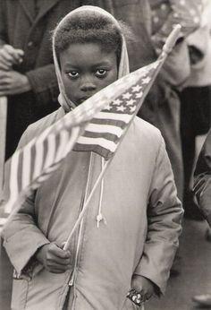 Black child at Civil Rights protest march, North Carolina. 1961. Photojournalist: Declan Haun / Black Star Publishing.