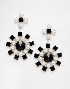 Earrings by Krystal Silver-tone finish Chandelier design Faux pearl detailing Swarovski crystal embellishment Bullet clutch back 70% Glass, 30% Brass