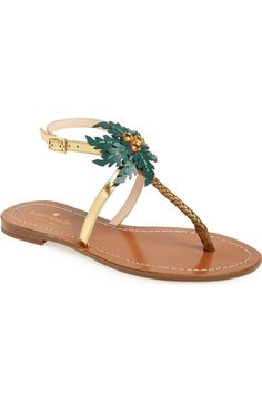 Inspired by the tropics and topped with crystal-coconut embellished leather fronds, these ankle-strap sandals from Kate Spade are perfect for warm summer days.