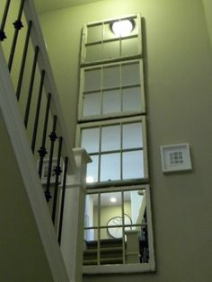 Old windows in stairwell, mirrored insert.  A cheaper option than finding Art big enough for these small stairwells!