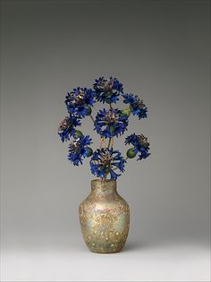 Imperial Cornflowers; Fabergé ca. 1900–05; Gold, silver, enamel; blown and iridized glass by the Imperial Glass Manufactory; Dimensions: 8 1/4 x 3 7/8 x 2 1/4 in. (21 x 9.8 x 5.7 cm); Created for Tsarina Alexandra Feodorovna